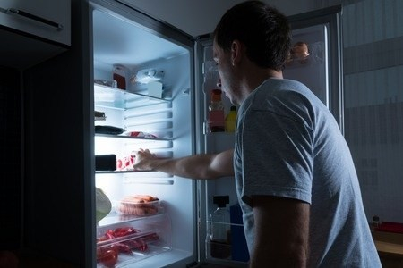 35689896 - portrait of a man taking food from refrigerator